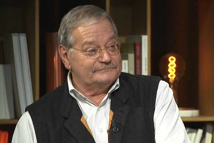Француски новинар Жак Мерлино (Фото: Снимак екрана/Јутјуб)