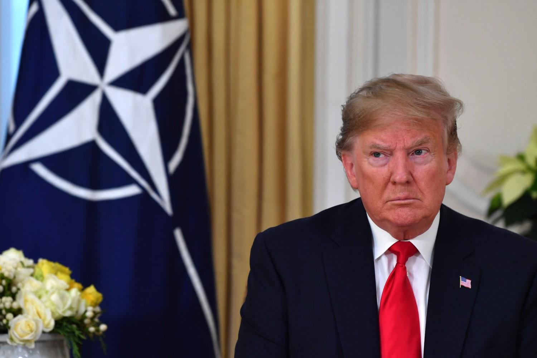 Američki predsednik Donald Tramp tokom razgovora sa generalnim sekretarom NATO Jensom Stoltenbergom, London, 03. decembar 2019. (Foto: Nicholas Kamm/AFP via Getty Images)