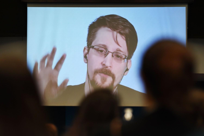 Бивши припадник ЦИА и узбуњивач Едвард Сноуден се обраћа учесницима конференције о заштити узбуњивача путем видео-преноса, Стразбур, 15. март 2019. (Фото: Frederick Florin/Agence France-Presse via Getty Images)