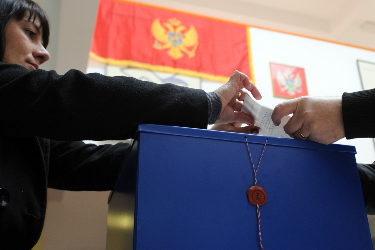 Image: 0158094063, License: Rights managed, A Montenegrin voting committee member (L) checks a ballot at a polling station in Podgorica on April 7, 2013. Montenegro began voting Sunday in a presidential election tipped to give the incumbent, Filip Vujanovic, a third mandate that would cement the ruling coalition's grip on power in the economically struggling Balkan state aiming to join the EU., Place: MONTENEGRO, Model Release: No or not aplicable, Credit line: Profimedia.com, AFP
