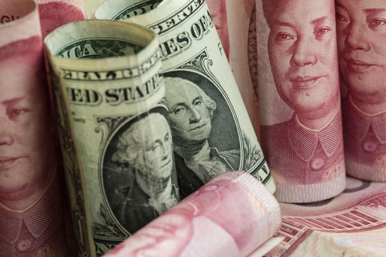 Novčanice američkog dolara i kineskog jena (Foto: Fred Dufour/AFP)