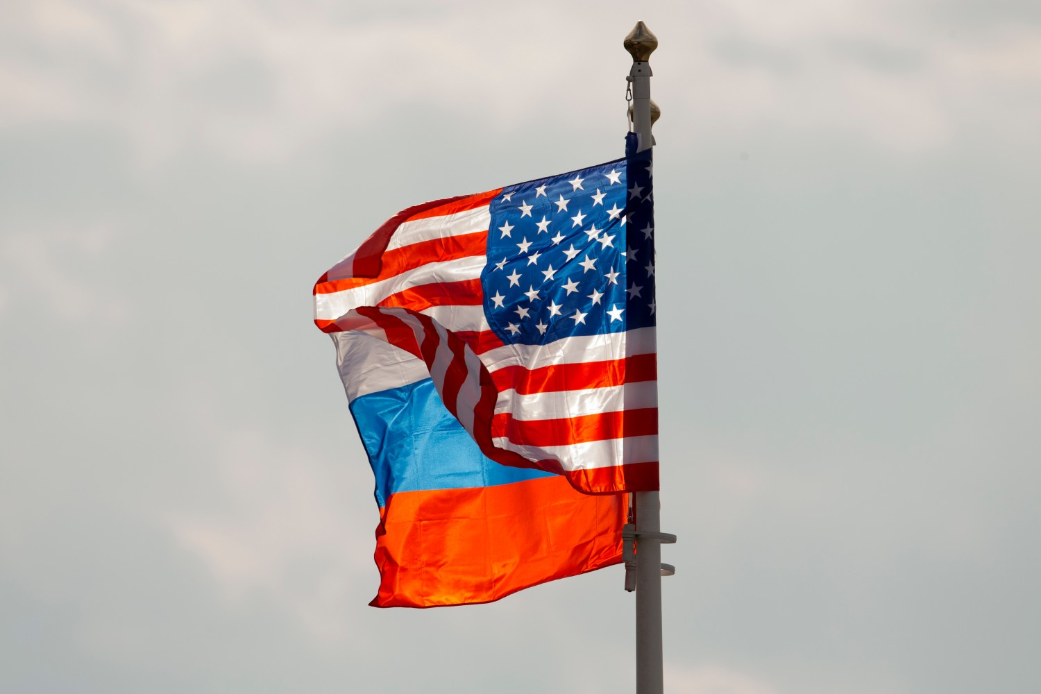 """FILE - in this Tuesday, April 11, 2017 file photo U.S. and Russian national flags wave on the wind before US Secretary of State Rex Tillerson's arrival in Moscow's Vnukovo airport, Russia. Russia on Friday, Sept. 1, 2017 promised a """"tough response"""" after U.S. issued its order to shut the Russian Consulate in San Francisco and offices in Washington and New York and gave Russia 48 hours to comply, intensifying tensions between the two countries. (AP Photo/ Ivan Sekretarev, file)"""
