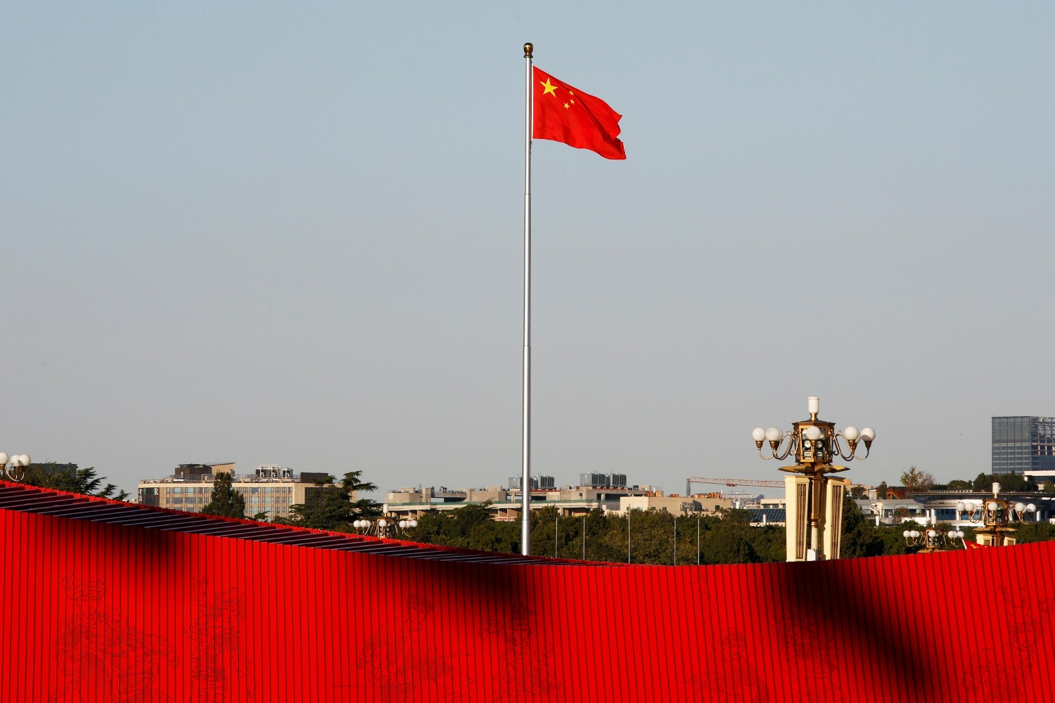 A Chinese flag flutters at the Tiananmen Square in Beijing, China October 25, 2019. REUTERS/Florence Lo
